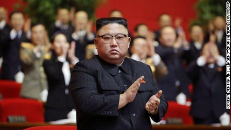 Kim Jong Un claps his hands at the Workers' Party Congress on Sunday, January 10.
