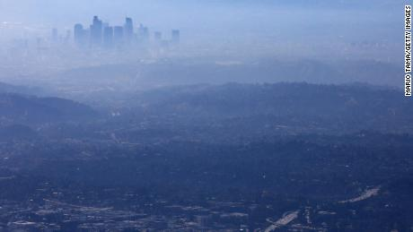 The buildings of downtown Los Angeles are partially obscured at midday on November 5, 2019 as seen from Pasadena, California, because of poor air quality.
