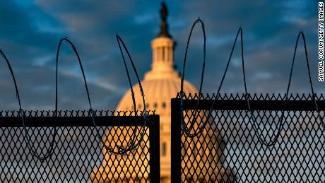 The US Capitol is seen at the top with razor wire in Washington on Saturday.