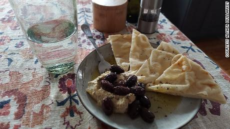 Althea Mullarkey's dinner routine includes lemon-dill hummus, olives and toasted naan with spicy oil.