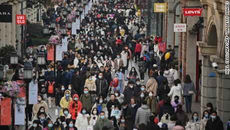 Crowds have returned to Wuhan's famous Jianghan shopping street, which was desserted this time last year.