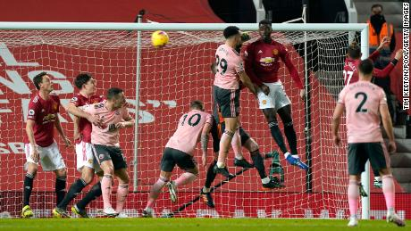 Bryan scores Sheffield United's first goal against Manchester United.
