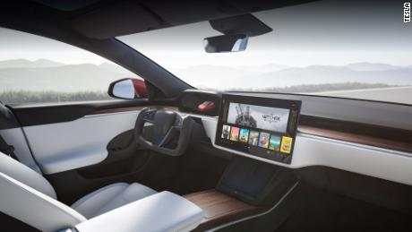 An artistic rendition of the interior of the new Model S with its signature steering wheel.
