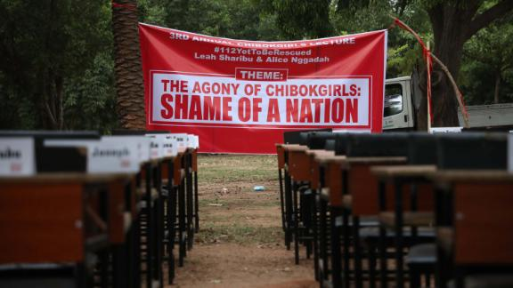 Names of the remaining Chibok schoolgirls are displayed with their desk on April 14, 2019, during the 5th Year Commemoration of the abduction of the 276 Chibok Schoolgirls by Boko Haram on April 14, 2014 from Government Secondary School, Chibok, Borno State. - On April 14, 2014, gunmen stormed the Chibok girls' boarding school, kidnapping 276 pupils aged 12-17, 57 of whom managed to escape by jumping from the trucks. After negotiations with Boko Haram, 107 of the girls either escaped, were released in exchange for prisoners or were recovered by the army. 112 Chibok girls are still missing. (Photo by Kola SULAIMON / AFP)        (Photo credit should read KOLA SULAIMON/AFP via Getty Images)