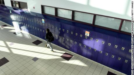 A student walks the halls between classes on January 25, Colorado's Arvada West High School, on the first day of learning.