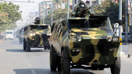 Armoured personnel carriers are seen on the streets of Mandalay on February 3, 2021.