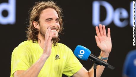 Stefanos Tsitsipas laughs while giving his interview.