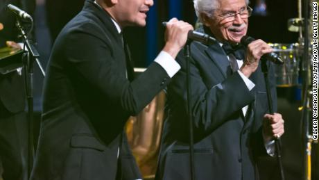 Johnny Pacheco sings with Victor Manuel at the 22nd ASCAP Latin Music Awards in 2014.