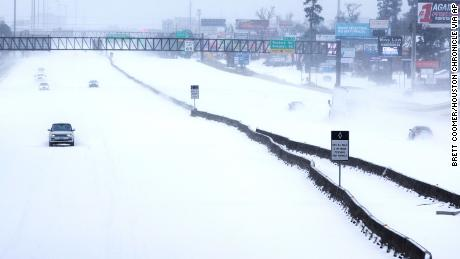Snow covered Interstate 45 Monday in The Woodlands, Texas.