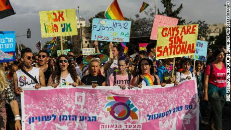 Participants hold placards and banners during the annual Gay Pride Parade in Jerusalem.