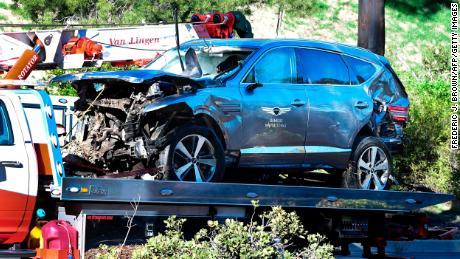 A tow truck recovers Tiger Woods' vehicle in Rancho Palos Verdes, California, on February 23, after a rollover accident.