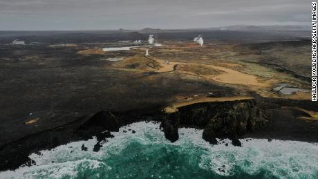 Aerial view taken on February 28, 2021 shows the lighthouse and the geothermal energy plant near the town of Grindavik on the Reykjanes peninsula, Iceland.