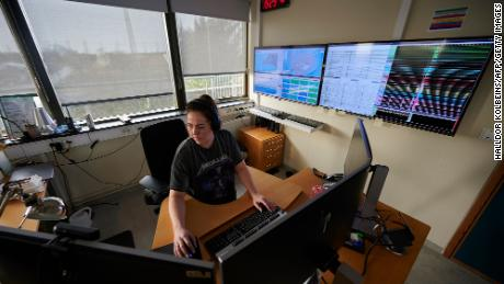 Picture taken on February 27, 2021 shows a natural hazards specialist at the Icelandic Meteorological Office in Reykjavik, which is surveying the situation at the Reykjanes peninsula, Iceland.