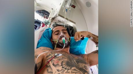 Kemper is pictured on board an emergency medevac flight after surviving a serious accident while surfing in Morrocco in 2020.