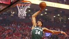 Antetokounmpo dunks the ball during the first half against the Toronto Raptors.
