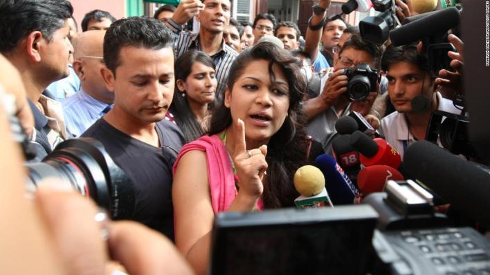 Sobhraj's wife, Nihita Biswas, speaks with media outside the Supreme Court in Kathmandu on July 30, 2010.