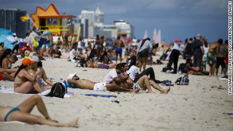 People gather on a beach in Miami on Saturday, March 5, 2021