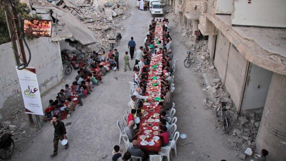 Residents of the war-torn city of Douma break their Ramadan fast on June 18, 2017.
