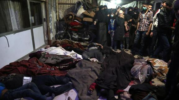Bodies lie on the ground in the rebel-held city of Douma, Syria, on April 8, 2018. According to activist groups, helicopters dropped barrel bombs filled with toxic gas on Douma, which has been the focus of a renewed government offensive that launched in mid-February. The Syrian government and its key ally, Russia, vehemently denied involvement and accused rebel groups of fabricating the attack to hinder the army's advances and provoke international military intervention.