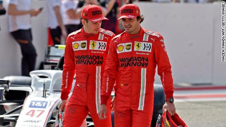 Leclerc (left) and Sainz (right) chat ahead of the first day of the F1 pre-season testing at the Bahrain International Circuit.