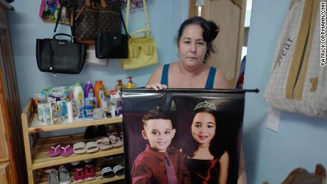 Jimenez holds a picture of her grandchildren Kenna Mariana, 6, and Luis Nesto, 4.