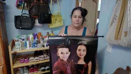 Jimenez holds a picture of her grandchildren Kenna Mariana, 6, and Luis Nesto, 4.
