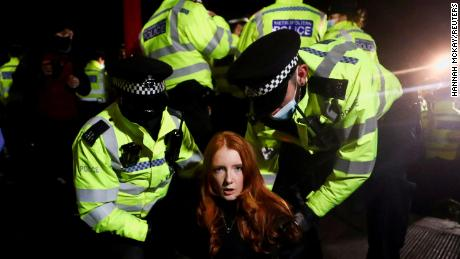 Police detain Patsy Stevenson on March 13 as people gathered at a peaceful memorial in London following the murder of Sarah Everard. Those scenes led to criticism of the police and increased scrutiny of the pending crime bill.