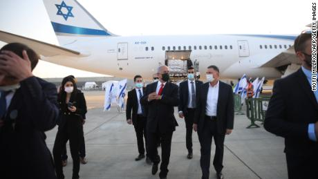 Netanyahu greets the first delivery of Pfizer-BioNTech vaccines at Ben Gurion airport on January 10.