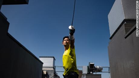 Miyake working out with a foil on the rooftop in Tokyo ahead of the postponed Olympics.