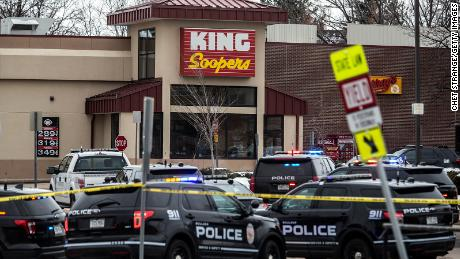Police respond at a King Soopers grocery store in Boulder where a gunman opened fire on Monday.