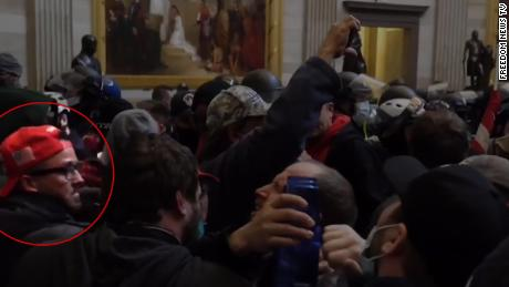 A screengrab taken from video shows Anthony Aguero, a conservative livestream and close ally of Rep. Majorie Taylor Greene, inside the US Capitol during the insurrection by pro-Trump rioters on January 6, 2020.
