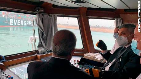 Lt. Gen. Ossama Rabei, head of the Suez Canal Authority, second right, speaks to other staff onboard a boat near the stricken cargo ship.