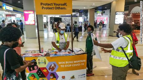 People learn how to prevent Covid-19 at a shopping center in the capital Port Moresby on September 4, 2020.