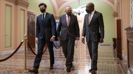 Senate Majority Leader Chuck Schumer, D-N.Y., center, is joined by Sen. Jon Ossoff, D-Ga., left, and Sen. Raphael Warnock, D-Ga., for a news conference to discuss the COVID relief bill, at the Capitol in Washington in February.