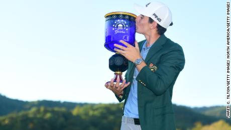 Niemann poses with the trophy after winning the Greenbrier Classic.