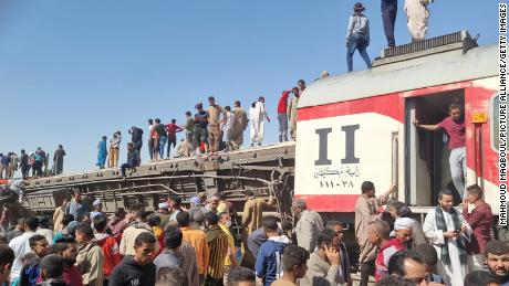 The damaged train cars after the passenger trains collided near Tahta.