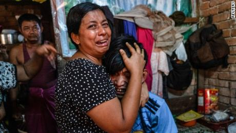 Family members cry in front of a man after he was shot dead during a crackdown on anti-coup protesters in Yangon, Myanmar, on Saturday.