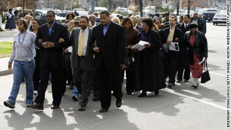 A group marches from the Tenth Street Baptist Church to the African-American Civil War Memorial January 15, 2007 in Washington to observe the birthday of Dr. Martin Luther King Jr.  Some Black churchgoers are socially conservative and open to voting for Republican candidates.