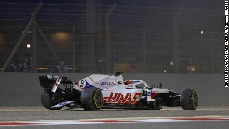 Haas F1's Russian driver Nikita Mazepin sits in his damaged car after crashing out during the Bahrain Grand Prix.