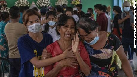 Family members and relatives attend the funeral ceremony of 13 year-old Sai Wai Yan, who was shot dead while playing outside his house in Yangon, Myanmar on March 28.