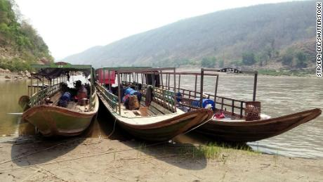 Boats of ethnic Karen villagers fleeing from air attacks by Myanmar military, are seen after crossing the Thai-Myanmar border in Mae Hong Son province, Thailand on March 28.
