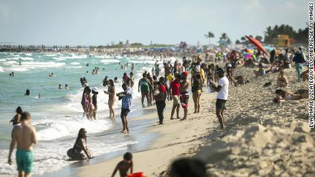 People gather in the South Beach neighborhood in Florida on Saturday, March 27, 2021.