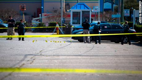 Virginia Beach police work the scene of a shooting that occured the night before.