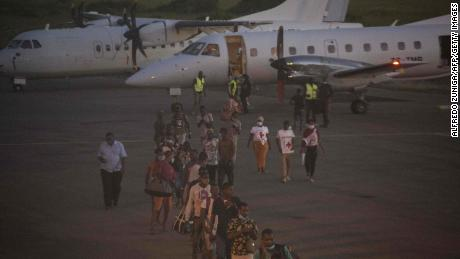 People evacuated from Palma arrive on an humanitarian flight at the airport in Pemba on March 31.