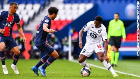 PSG's Marquinhos watches Jonathan David of Lille with the ball during the French Ligue 1 match between the two teams at the Parc des Princes on April 3.