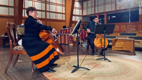 Salamander Hotels & Resort owner Sheila Johnson, left, plays the cello during a lesson with instructor Alan Saucedo Estrada in Middleburg, Virginia, in this undated photo.