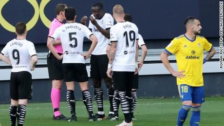 Mouctar Diakhaby (C) talks with referee David Medie Jimenez (2-L) after allegedly receiving a racist comment.