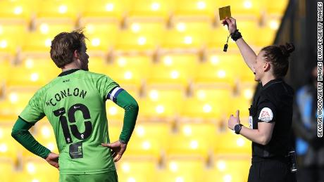 Rebecca Welch shows a yellow card to Tom Conlon of Port Vale in Monday's match.