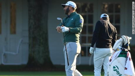 Johnson warms up on the range during a practice round prior to the Masters.