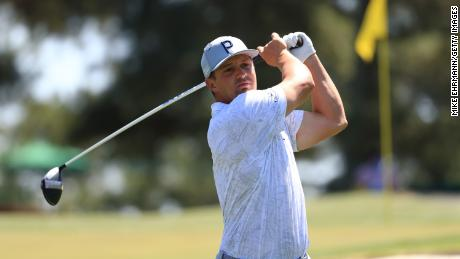 DeChambeau plays his shot from the third tee during a practice round prior to the Masters.